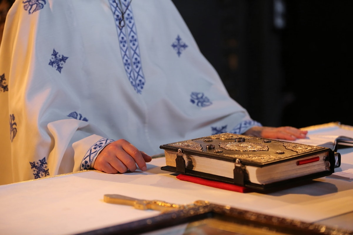 book, priest, bible, religion, indoors, man, table, furniture, hand, work