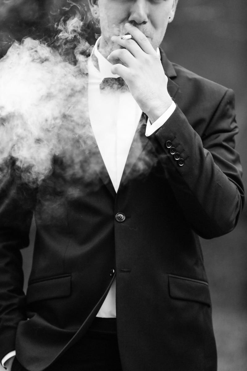 cigarette, smoke, tuxedo suit, clothing, business, garment, suit, person, man, businessman