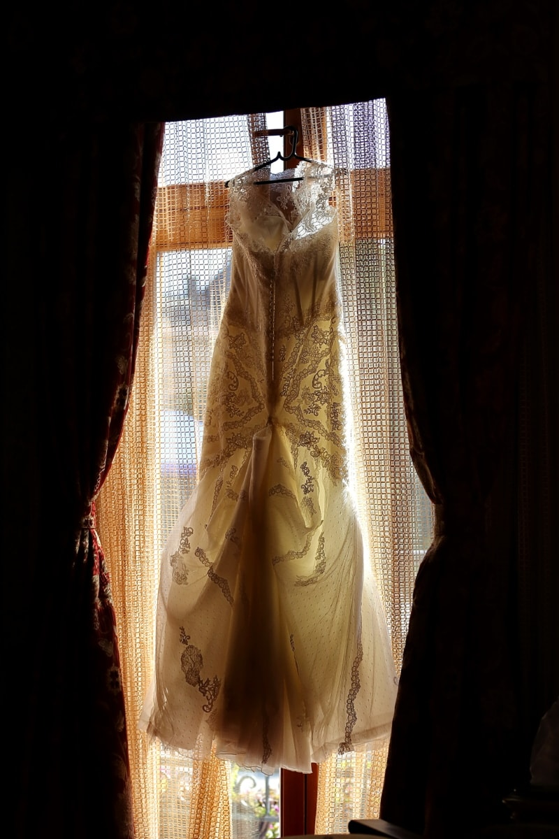 wedding dress, hanging, window, backlight, covering, clothing, statue, style, fashion, garment