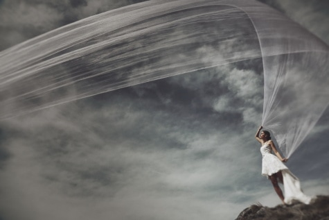 photo model, photomontage, wedding, wedding dress, veil, blue sky, wind, landscape, clouds, extreme