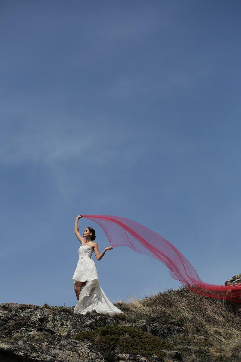 young woman, bride, veil, red, wind, mountain peak, summer, grass, fun, field