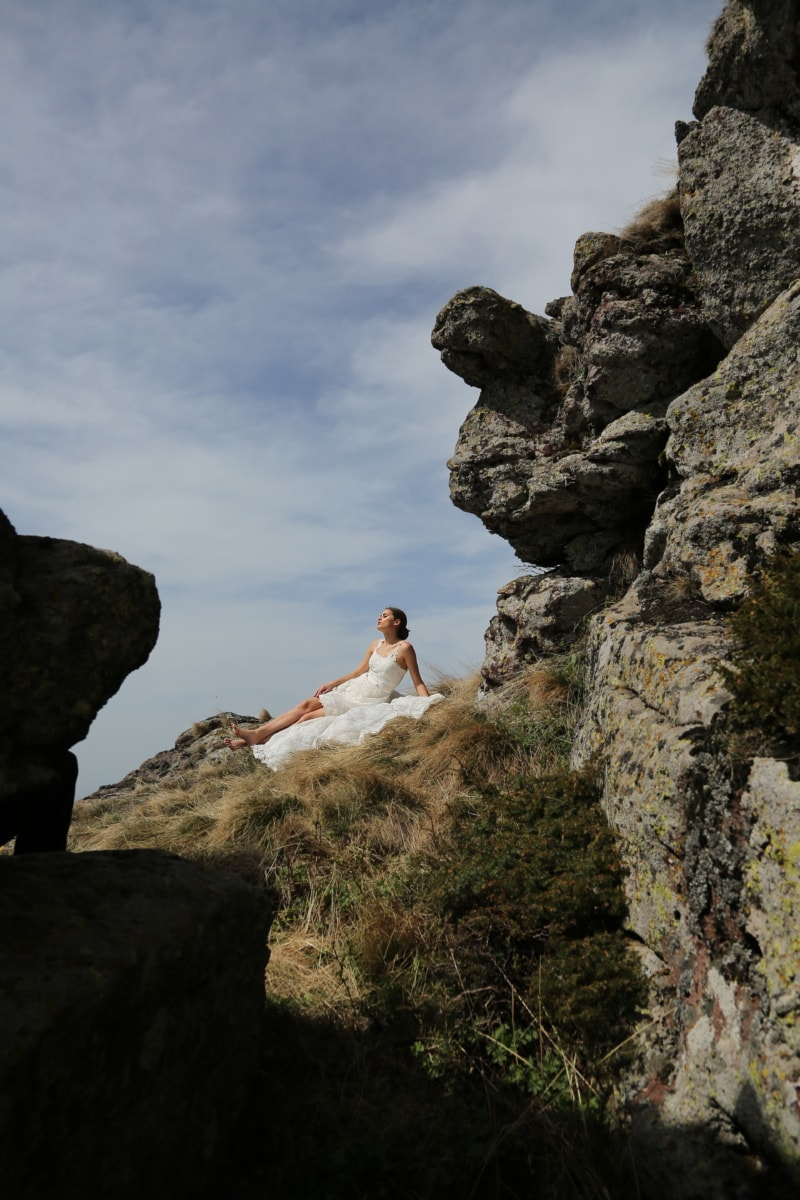 mountain peak, sunny, relaxing, laying, woman, enjoyment, landscape, cliff, mountain, rock