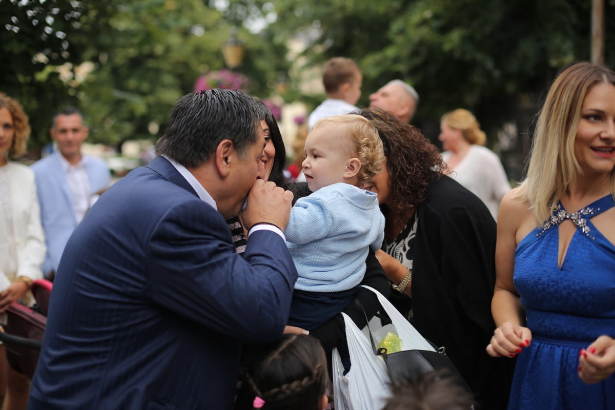 kiss, people, adorable, toddler, crowd, street, interaction, communication, happy, smiling