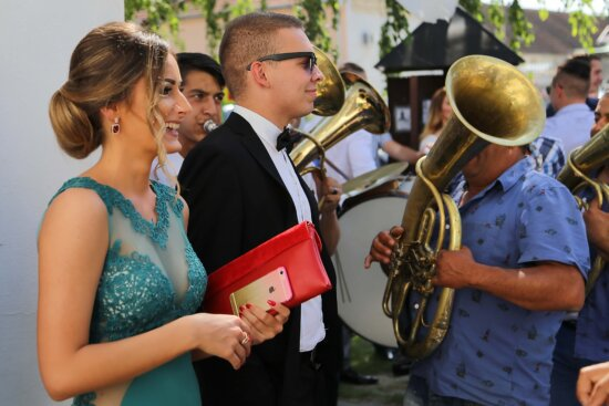 pretty girl, gorgeous, man, handsome, crowd, orchestra, suit, trumpeter, brass, music