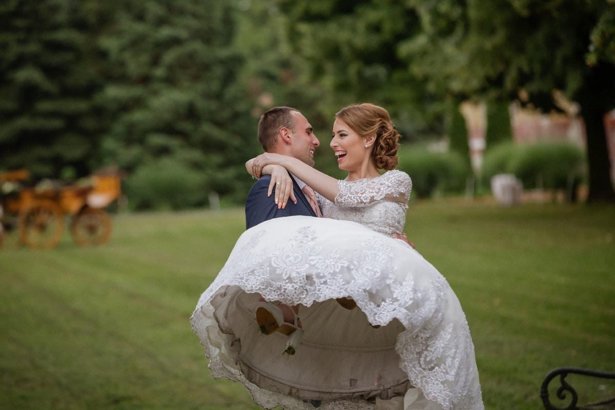 groom, holding, bride, outdoors, nature, wedding, love, woman, grass, veil