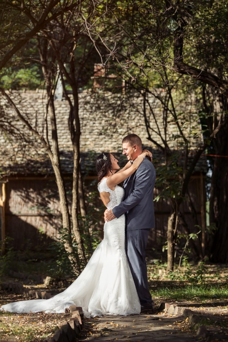 standing, newlyweds, bride, groom, cottage, village, countryside, nostalgia, love, romance