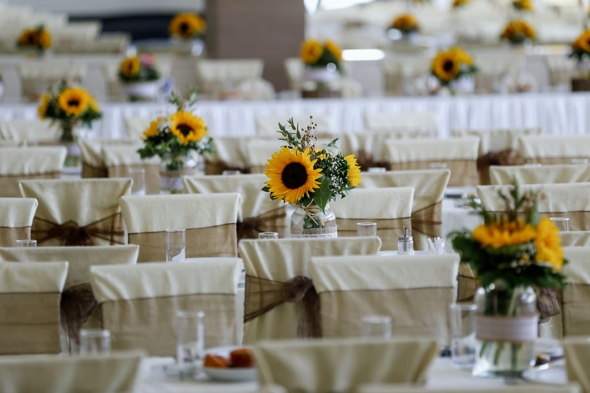 sunflower, tablecloth, vase, dining area, tables, silverware, cutlery, table, tableware, dining
