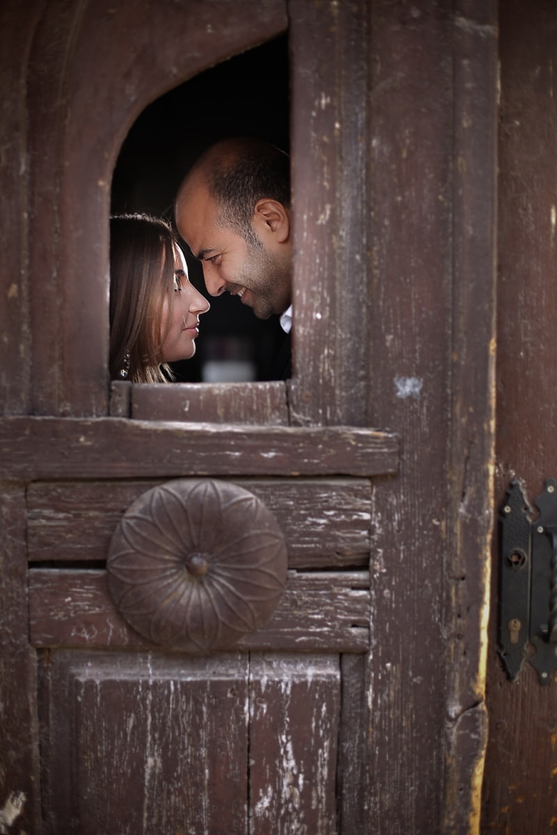 man, woman, front door, kiss, smile, hide, romance, door, people, old