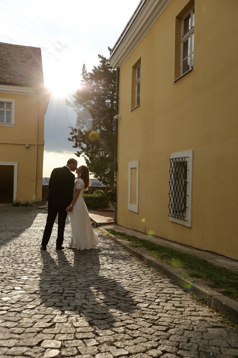 kiss, groom, bride, sunrays, sunny, street, wedding, people, architecture, woman
