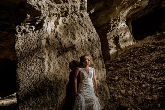 smiling, young woman, underground, cave, dress, fashion, sunlight, sunrays, girl, woman