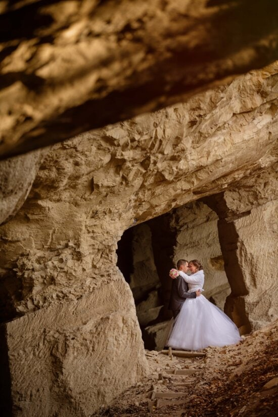 underground, just married, megalith, cave, couple, bride, groom, hiding, rock, people