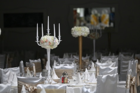 fancy, dinner table, wedding venue, dining area, candles, furniture, tablecloth, candlestick, table, luxury