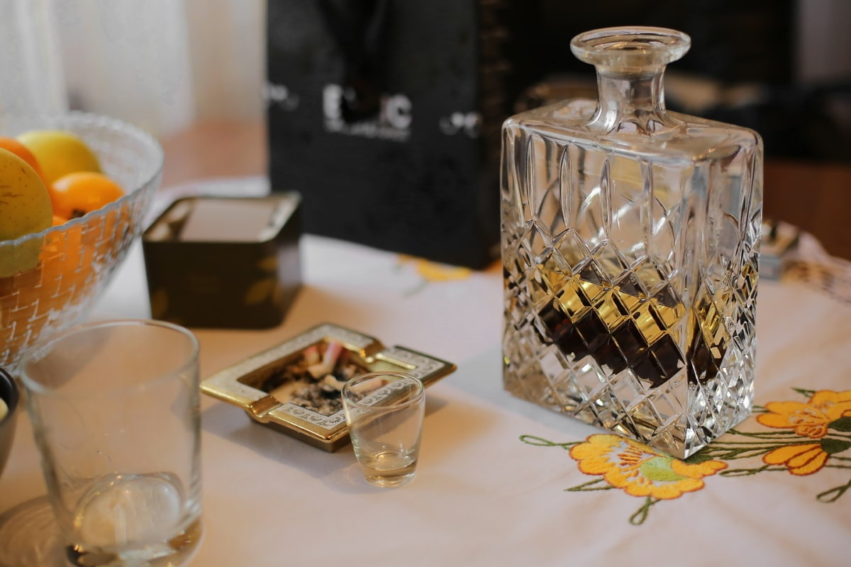 bottle, crystal, ashtray, cigarette, drinking, table, glass, drink, indoors, still life