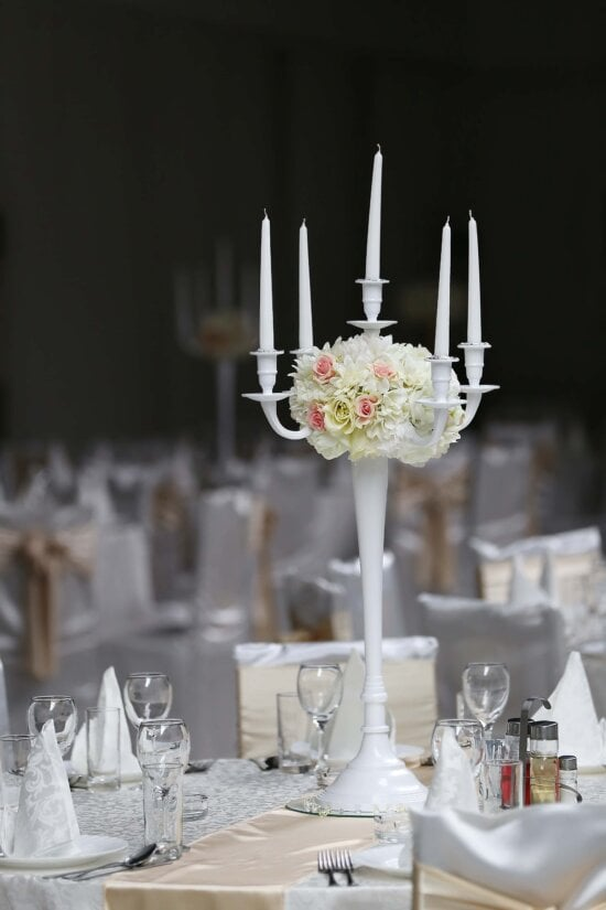 white, tall, candlestick, hotel, bouquet, wedding venue, elegant, reception, table, candle