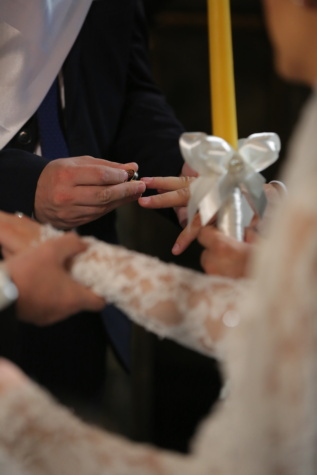 church, candles, wedding, wedding ring, groom, hands, bride, woman, people, man