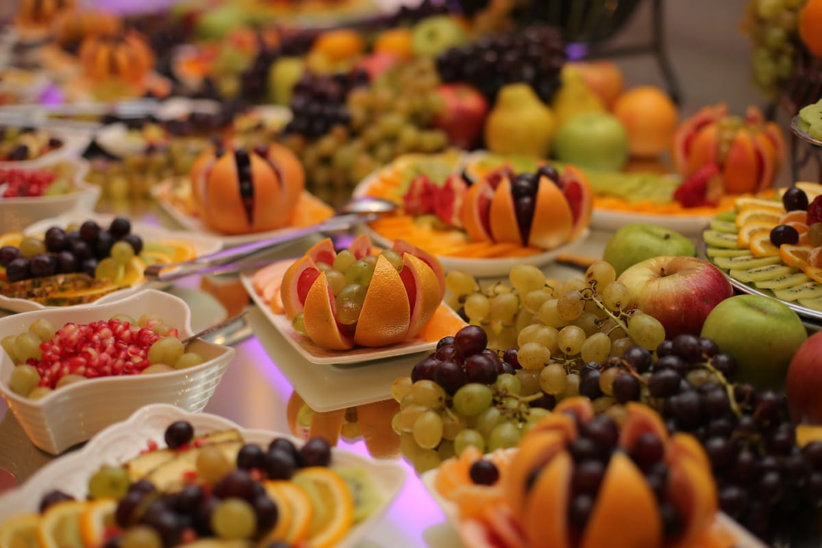 buffet, grapes, fruit, salad bar, oranges, citrus, pomegranate, apples, mandarin, delicious
