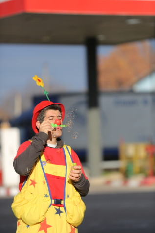 blowing, clown, bauble, entertainer, person, performer, street, people, outdoors, festival