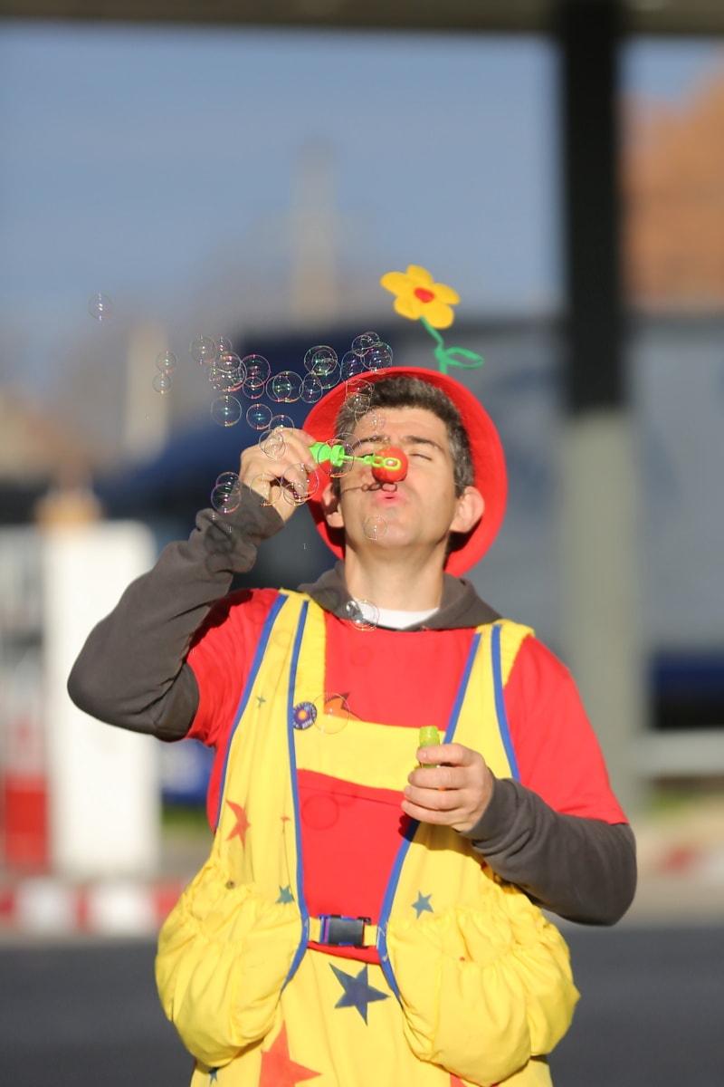 entertainer, bauble, clown, person, performer, street, outdoors, man, portrait, fun
