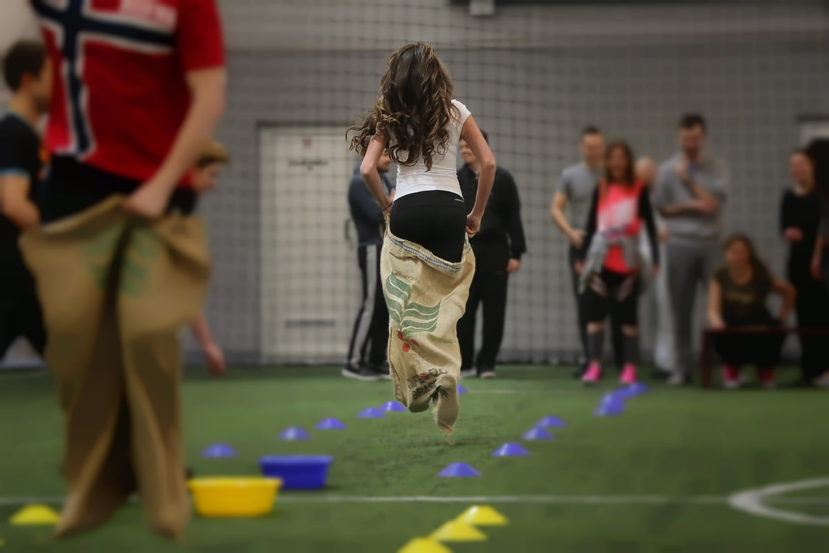 sack, race, game, competition, sport, player, grass, athlete, woman, people