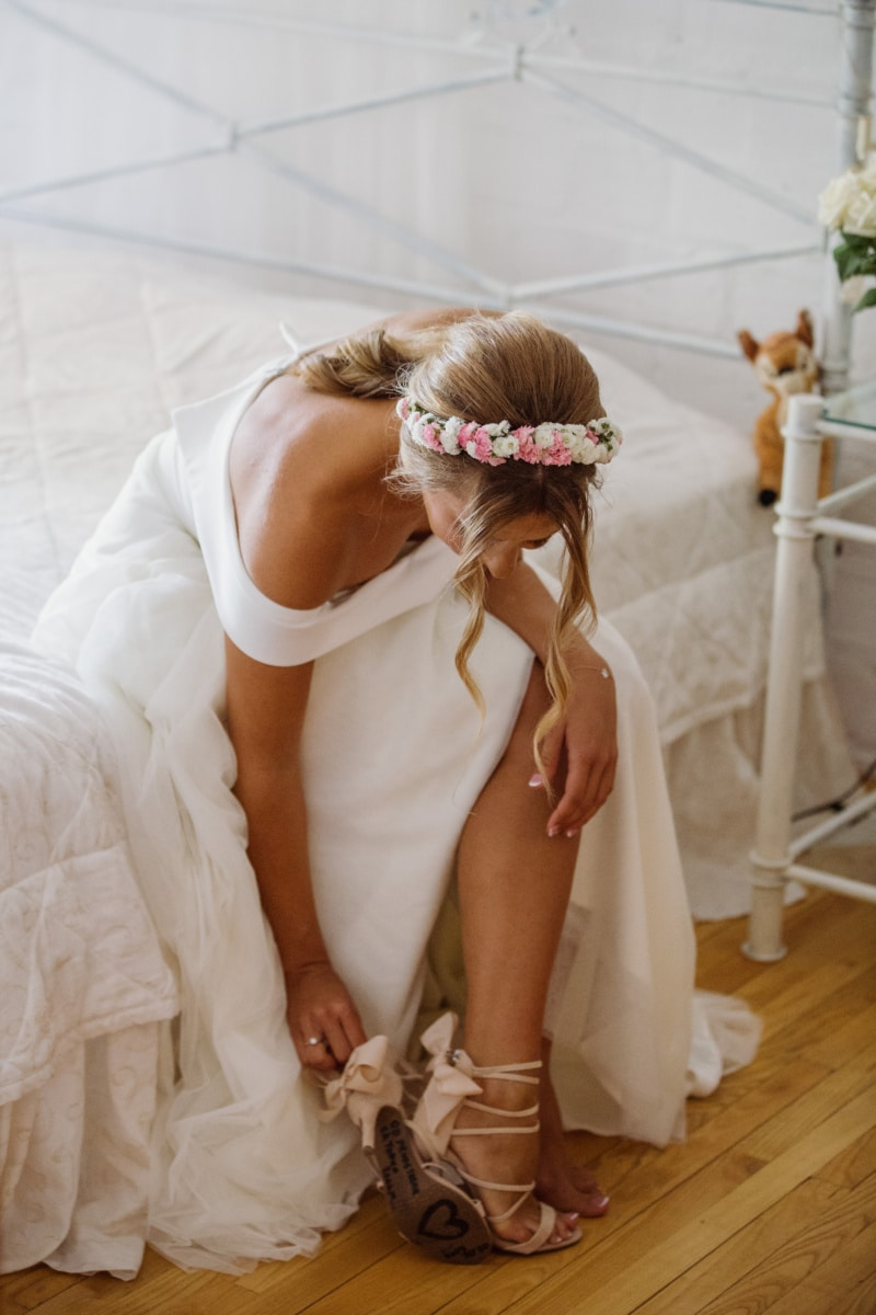 bedroom, bed, bride, sitting, shoes, sandal, wedding dress, wedding, clothing, woman
