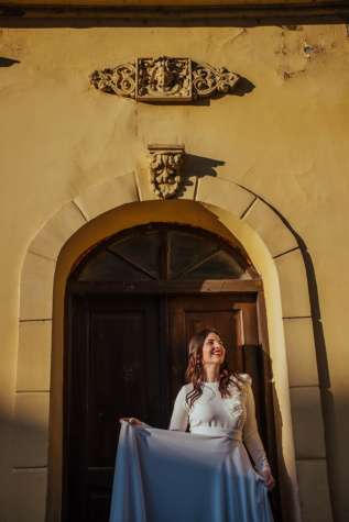 front door, smiling, exhilaration, young woman, dress, sunny, posing, church, building, architecture