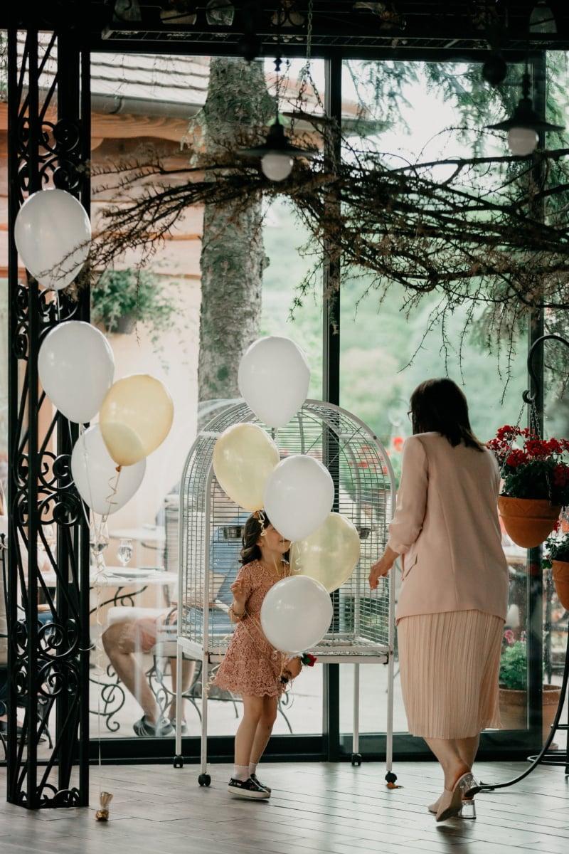 playful, child, cheerful, balloon, girl, woman, portrait, window, light, city