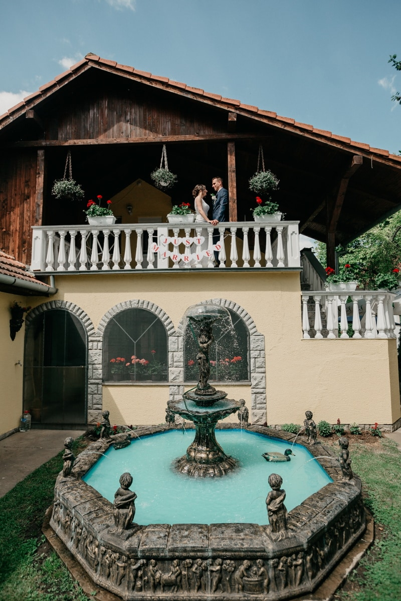 just married, bride, groom, balcony, backyard, villa, fountain, building, architecture, structure
