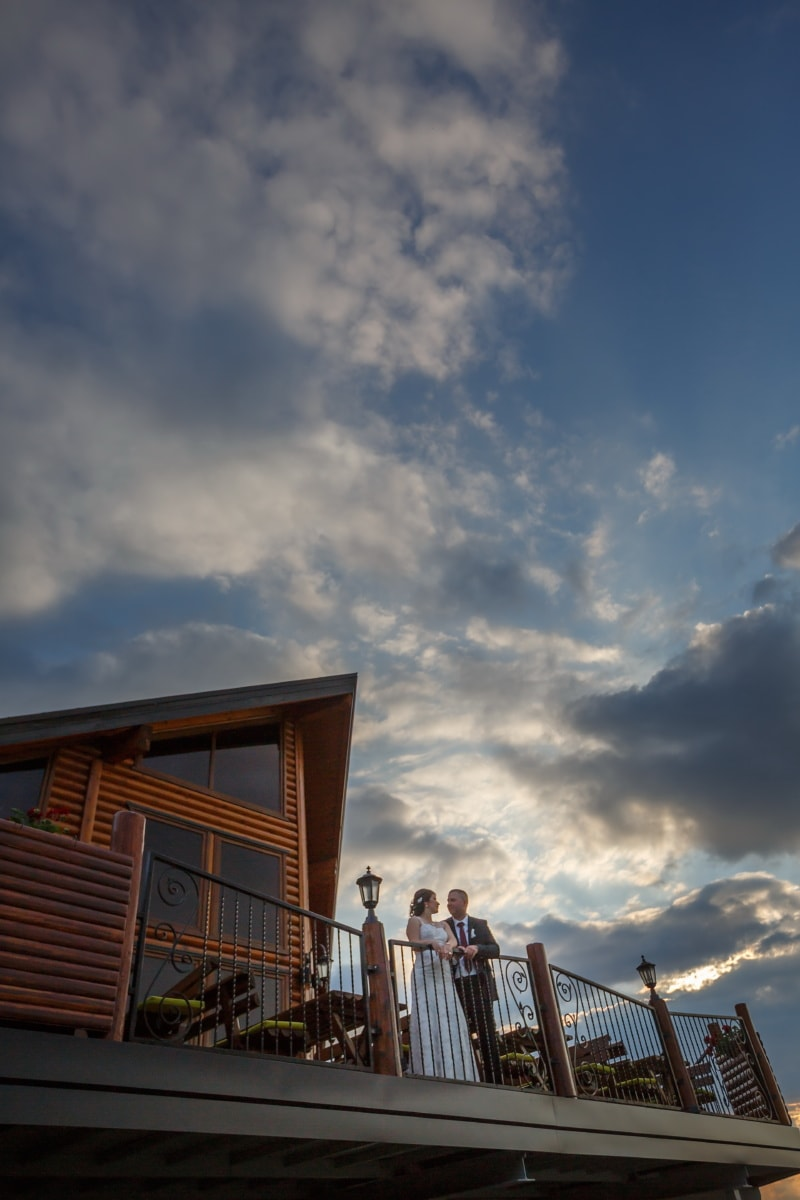 sunset, cottage, balcony, groom, bride, architecture, atmosphere, sun, outdoors, light