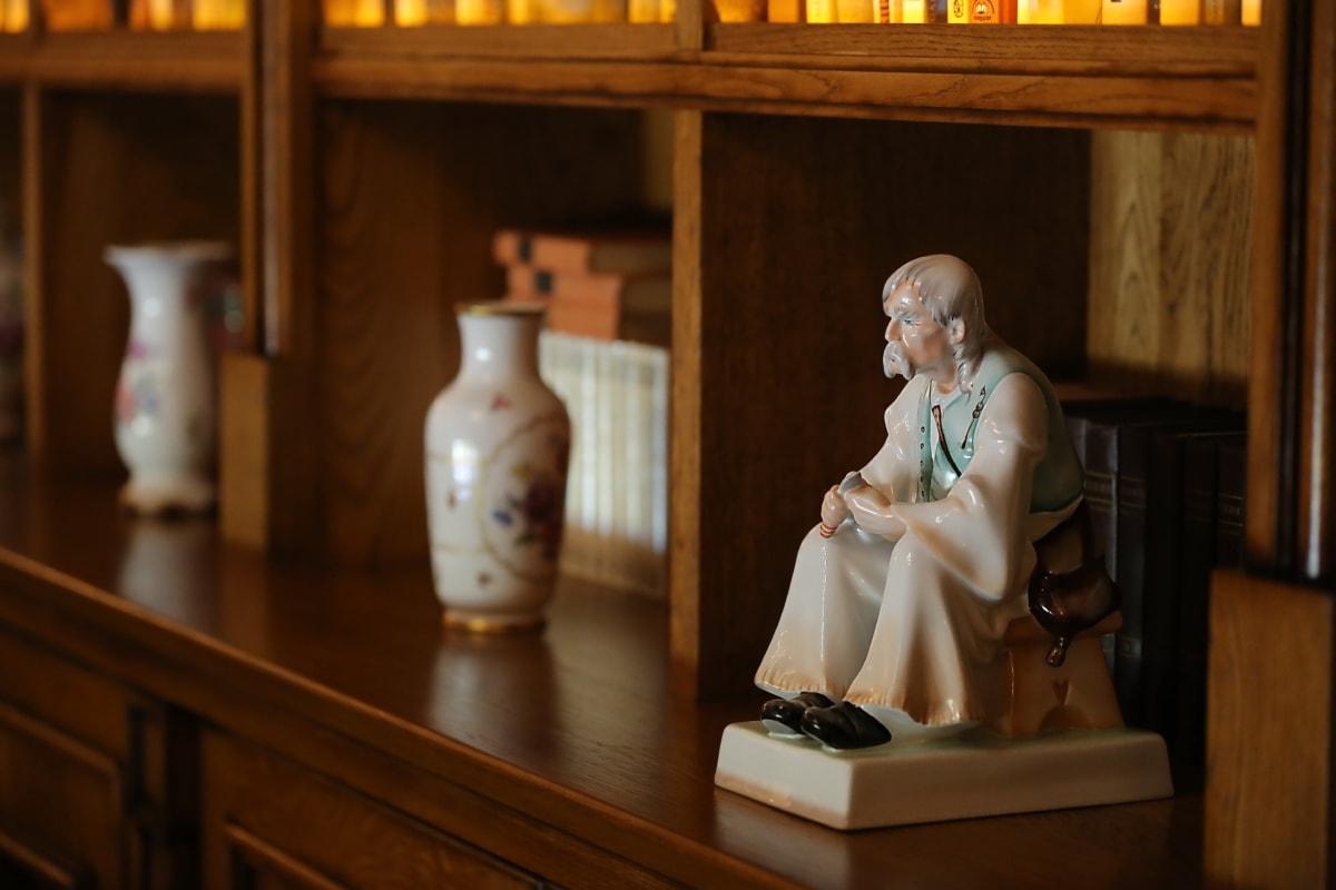 ceramic, figurine, fine arts, shelf, interior decoration, wood, furniture, indoors, portrait, room