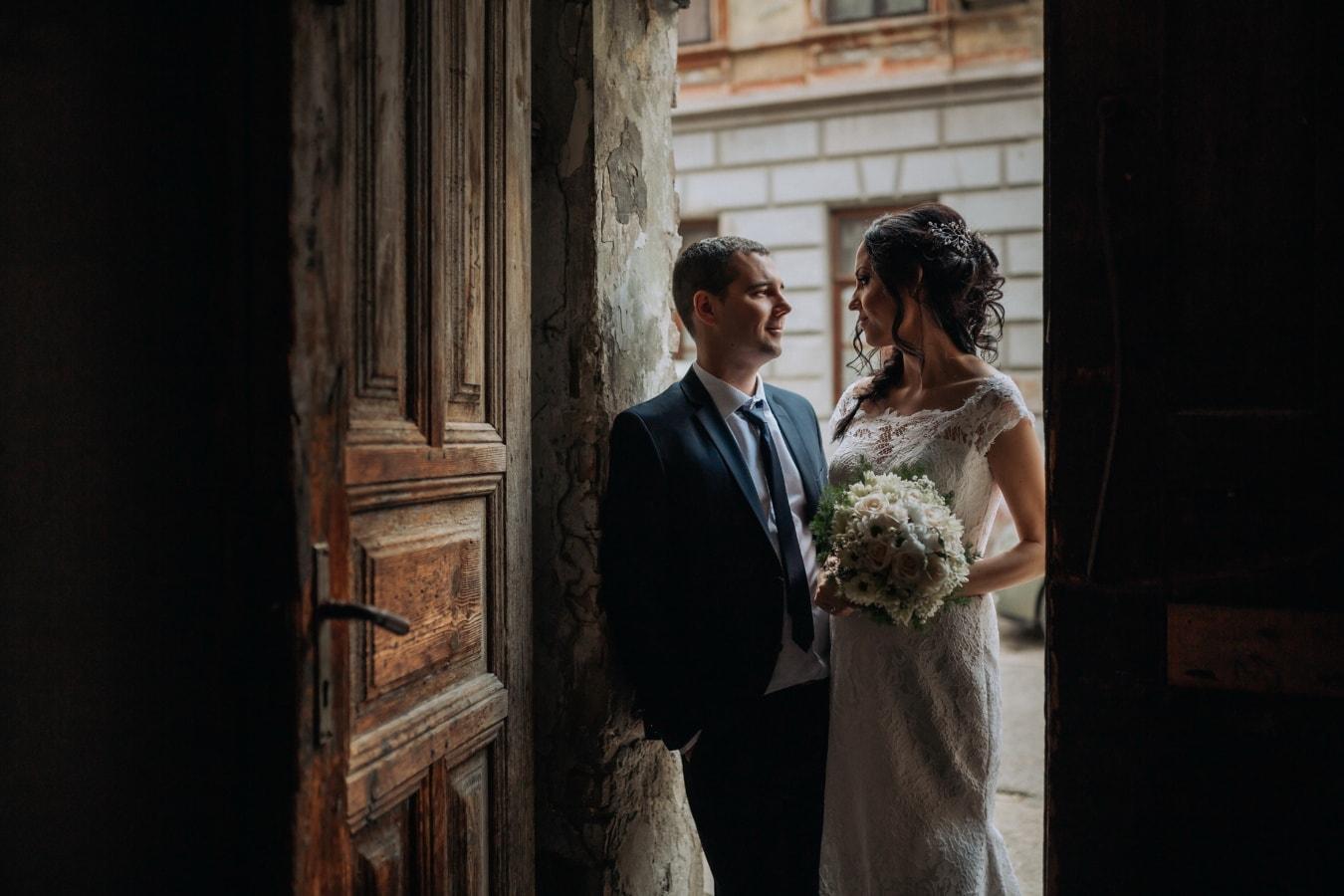 front door, entrance, shadow, just married, groom, bride, woman, wedding, man, people