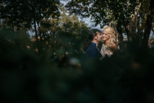 newlyweds, kiss, girl, groom, woman, blur, man, portrait, outdoors, wedding