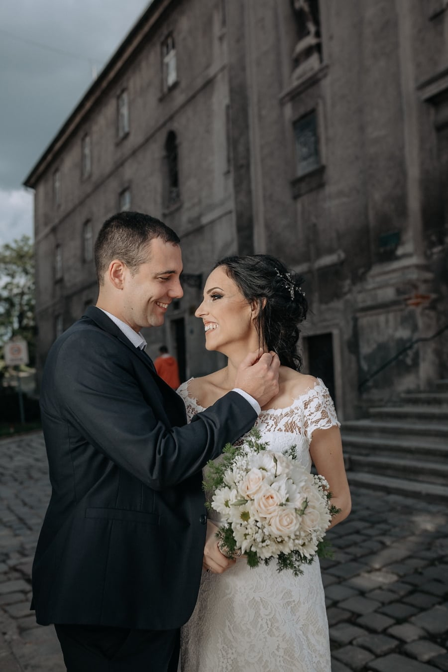 just married, hugging, smiling, architectural style, street, wedding, groom, bride, couple, man