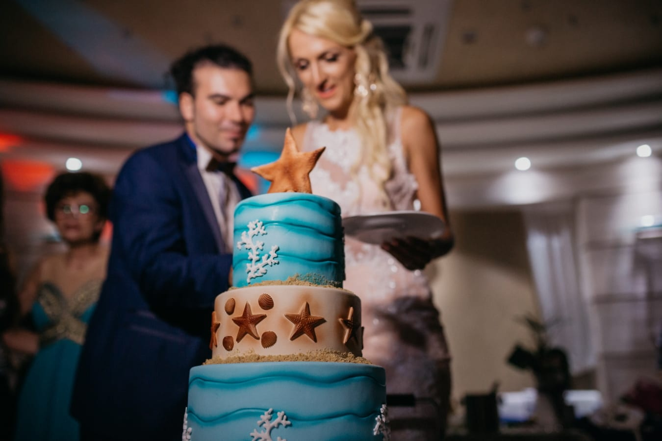 wedding cake, groom, bride, hotel, wedding venue, people, woman, indoors, man, portrait