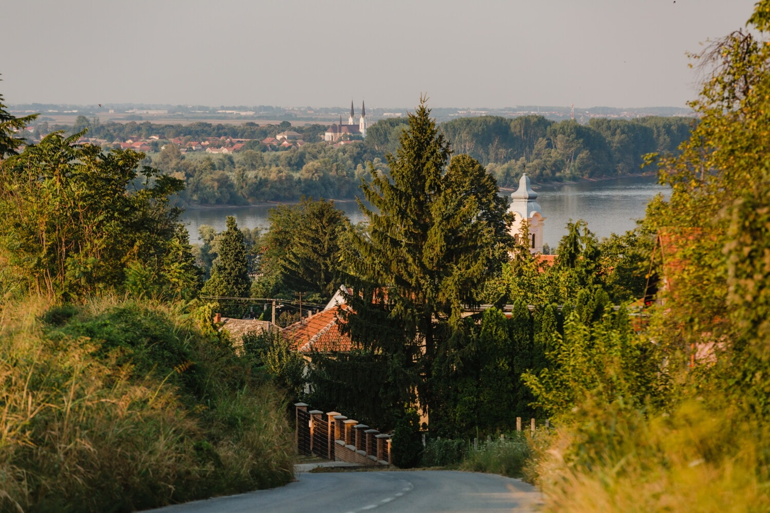 road, downhill, church tower, riverbank, urban area, tree, trees, forest, landscape, water