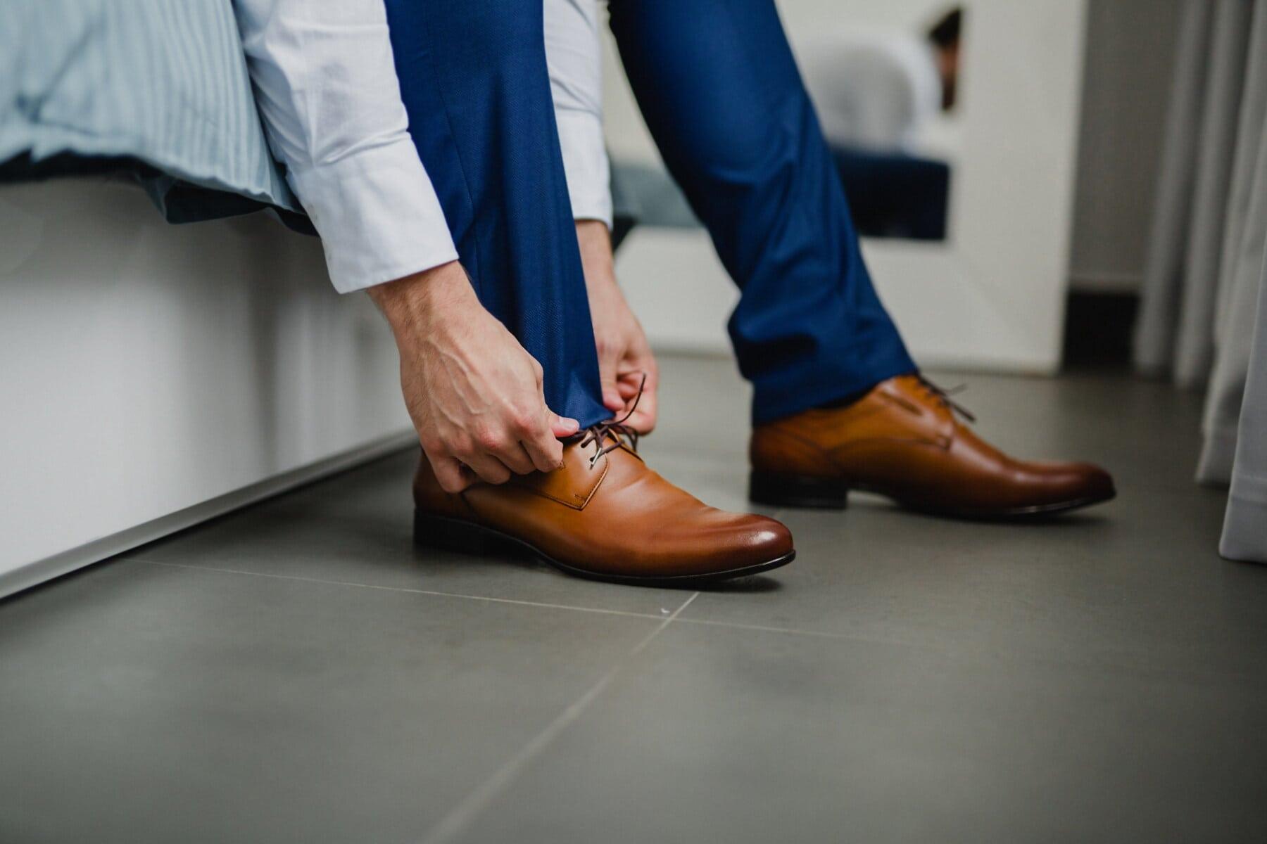 bed, bedroom, floor, legs, man, light brown, shoes, shoelace, footwear, foot