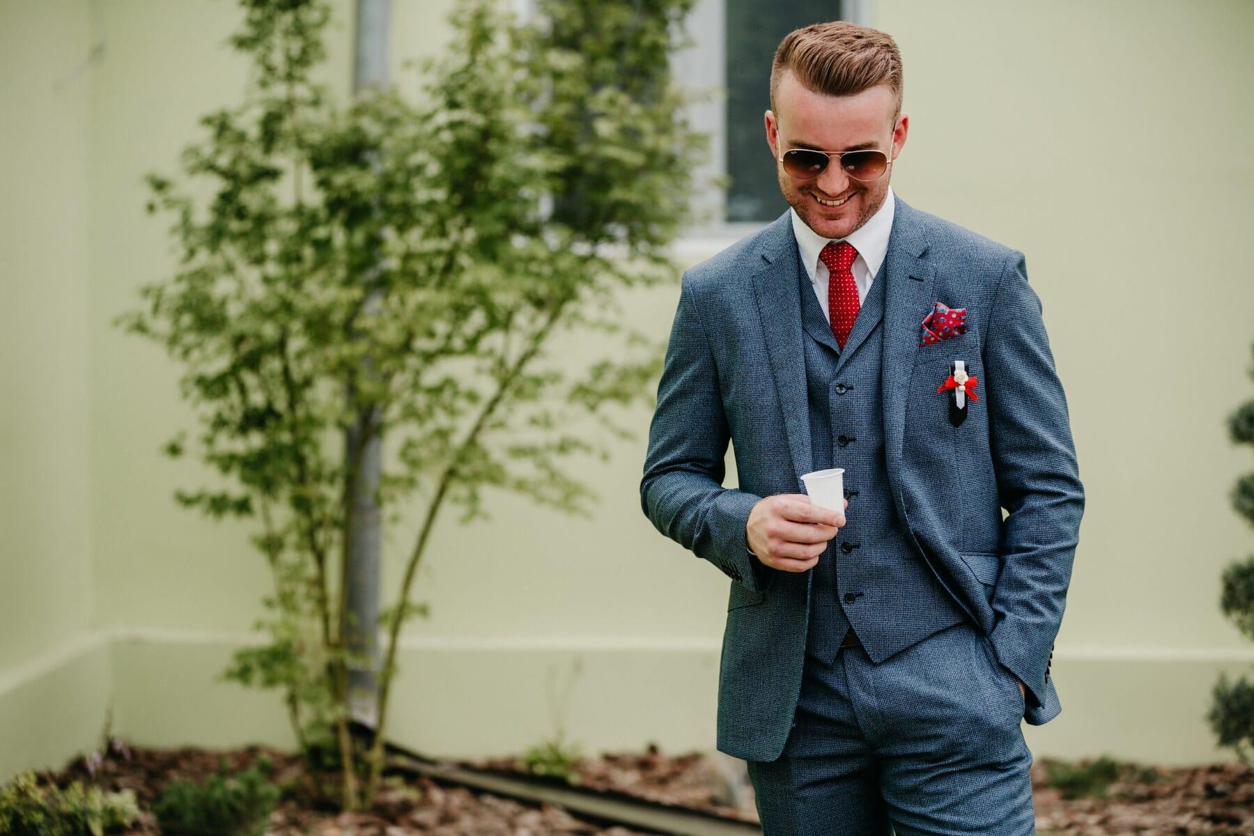 brunette, man, handsome, businessman, smile, tuxedo suit, tie, sunglasses, confidence, clothing