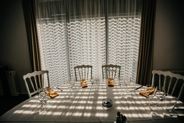 shadow, elegance, darkness, lunchroom, dining area, tablecloth, table, tableware, ashtray, chairs