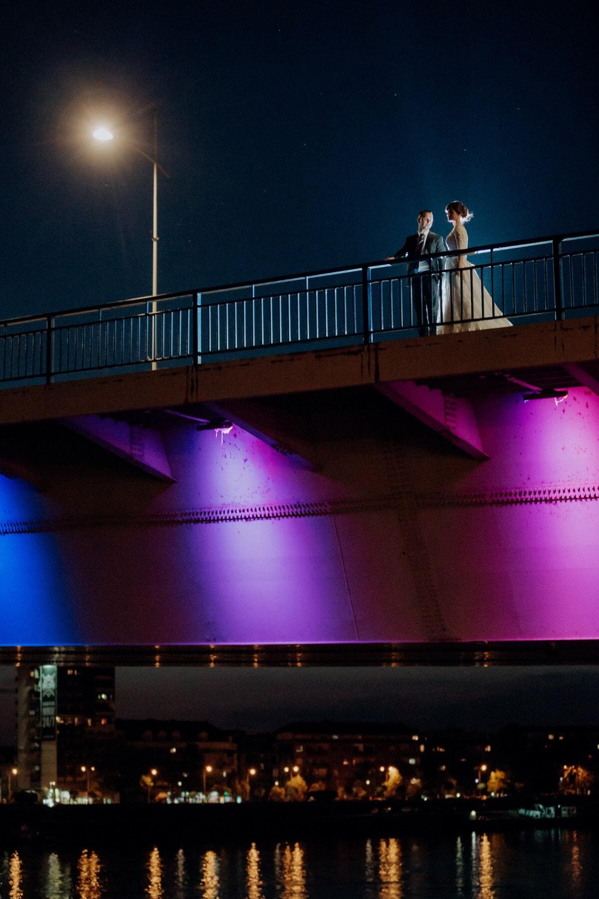 romantic, bridge, night, love date, man, young woman, lights, light, city, water