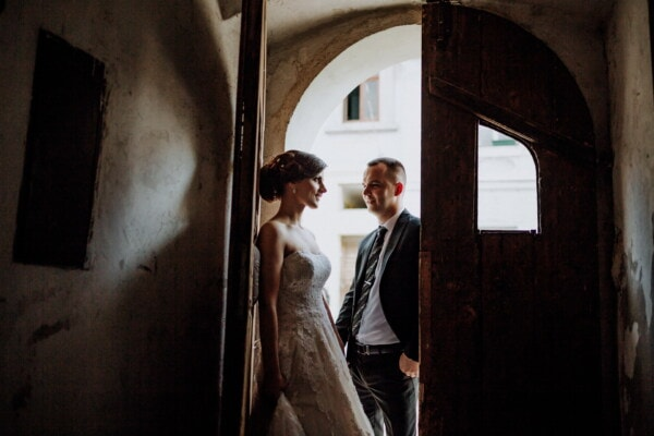 bride, groom, front door, doorway, architectural style, old, old style, gateway, portrait, people