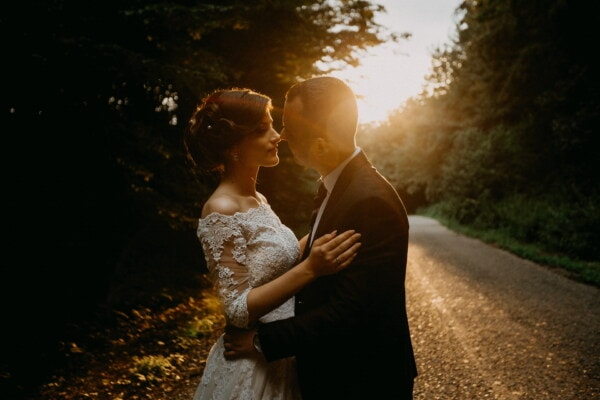 bride, kiss, groom, forest road, sunset, marriage, embrace, hugging, love, wedding