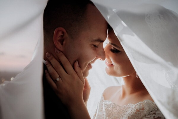 newlyweds, groom, bride, underneath, veil, wedding dress, kiss, wedding, love, woman