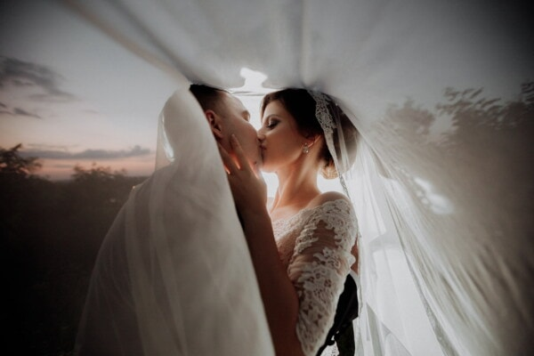 groom, bride, kiss, veil, sunset, wedding, woman, love, marriage, fashion