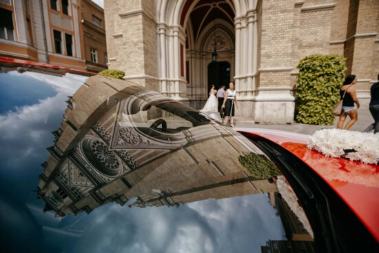 windshield, car, reflection, church tower, cathedral, street, building, architecture, people, outdoors