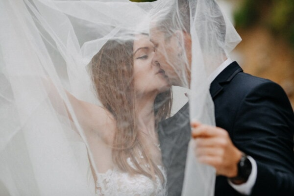 kiss, underneath, wedding dress, veil, groom, bride, wedding, woman, love, fashion