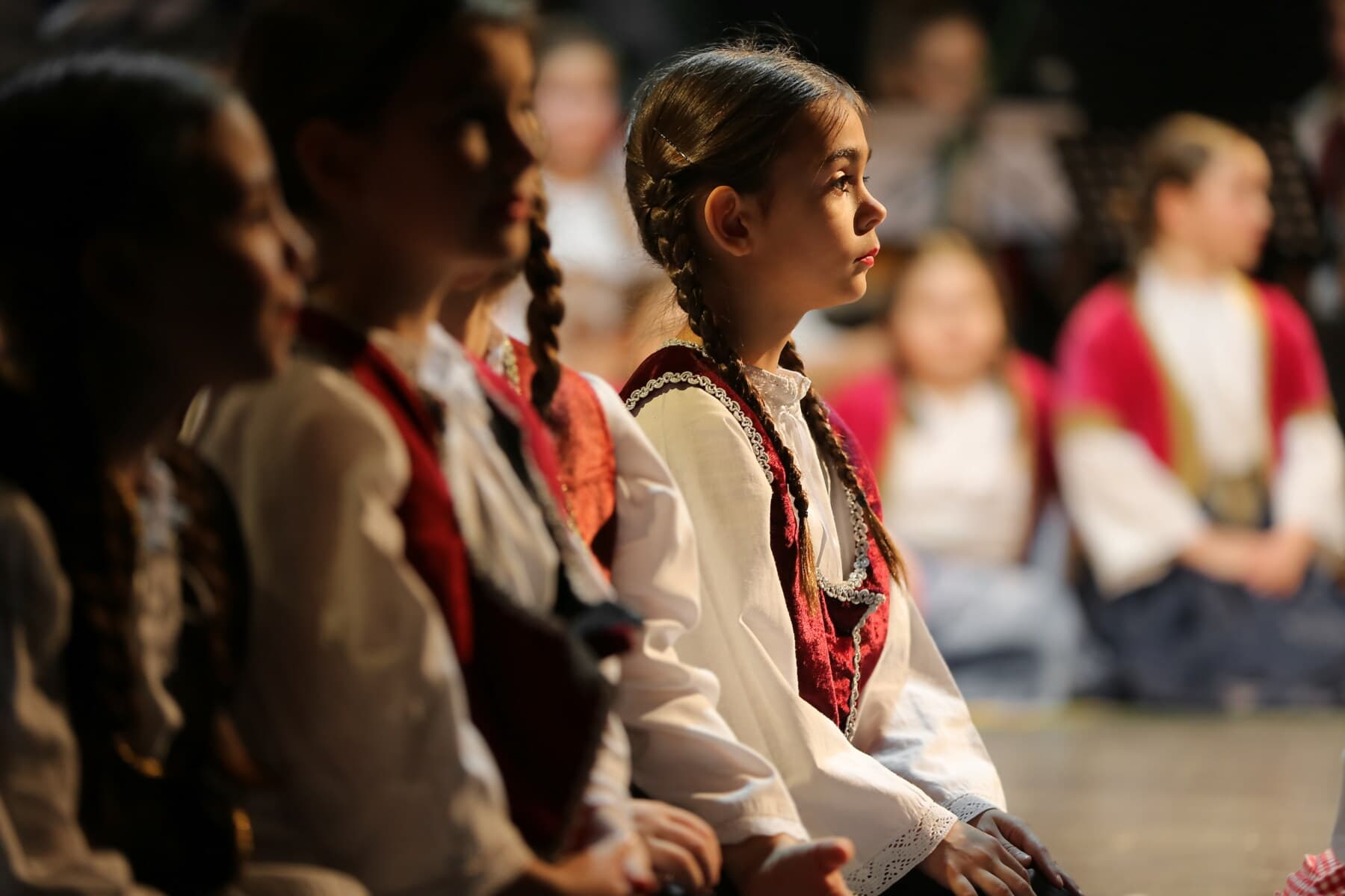 school child, girls, pretty, side view, sitting, concert, people, person, religion, group