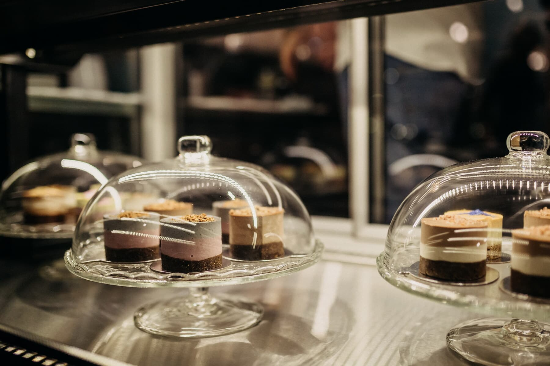 dessert, cookies, cake shop, underneath, glass, bell, indoors, restaurant, drink, tableware
