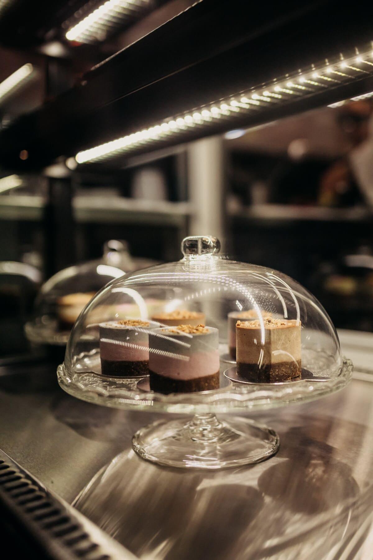 shelf, cake shop, glass, indoors, food, restaurant, still life, blur, light, chocolate