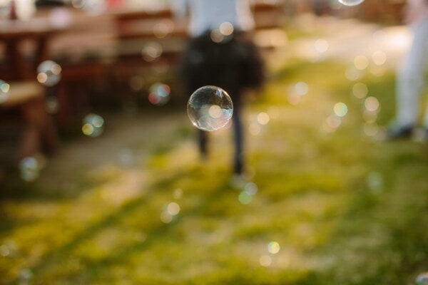 bauble, ear, levitation, round, sphere, flying, shining, reflection, focus, blur