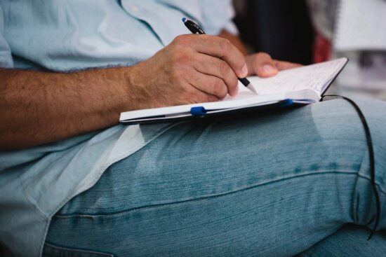 notebook, pencil, man, writing, hand, textil, sitting, pants, paper, business