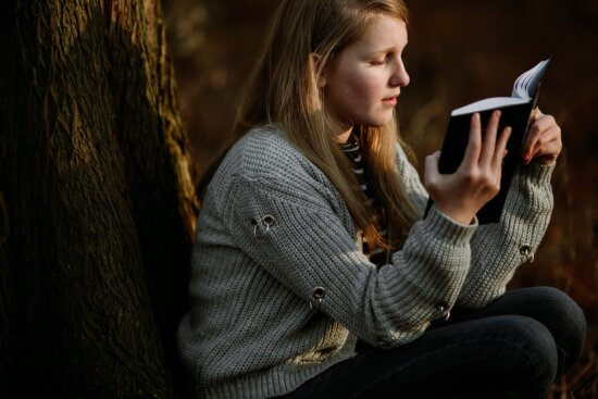 young woman, student, reading, book, tree, outdoor, outfit, sweater, knitwear, cardigan
